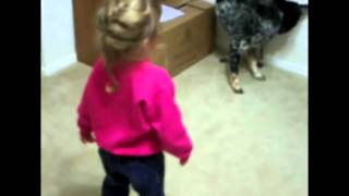 Dog And Little Girl Chasing Their Tails