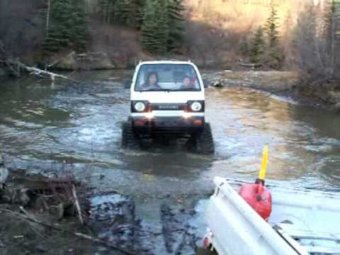 Suzuki carry mattracks going thru creek