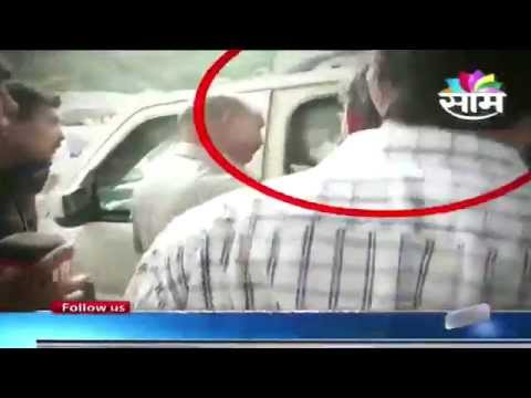 Vinod Tawde try to get into Rajnath Singh's car; guard denies