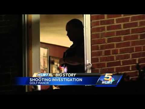 Couple shot while sleeping in Golf Manor home