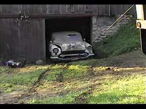 1951 Ford wrecker pulling antique cars out of barn Pt2