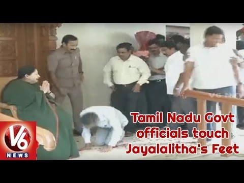 AIADMK Activists And Tamil Nadu Govt officials touch Jayalalitha's feet after winning the polls