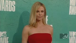 FKN Cunt Charlize Theron Adopts a Second Niglet Child Future Baboon Threat to White Females