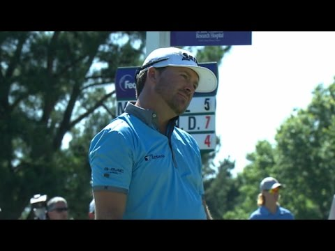 Graeme McDowell's tee shot on No. 14 rattles the pin at FedEx St. Jude