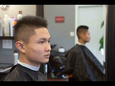 Fade Haircut. Long on top 1 on the sides.