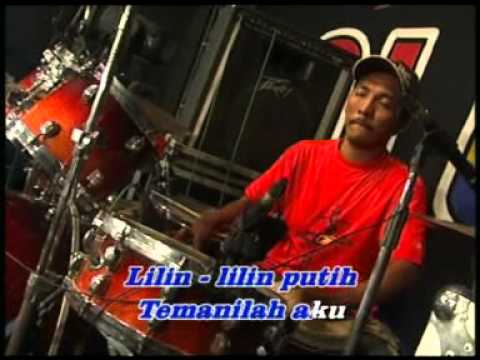 Evie Tamala - Lilin-Lilin Putih [Official Music Video]