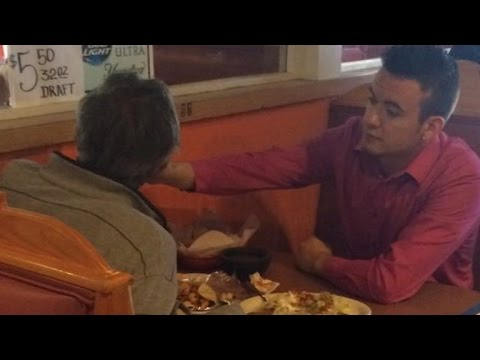 Waiter Helps Feed Tacos To Customer With No Hands