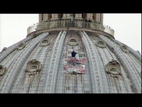 Anti-euro protester atop St. Peter's in Rome - no comment