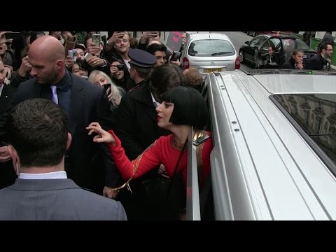 EXCLUSIVE - All red Lady Gaga leaves the Bristol Hotel in Paris