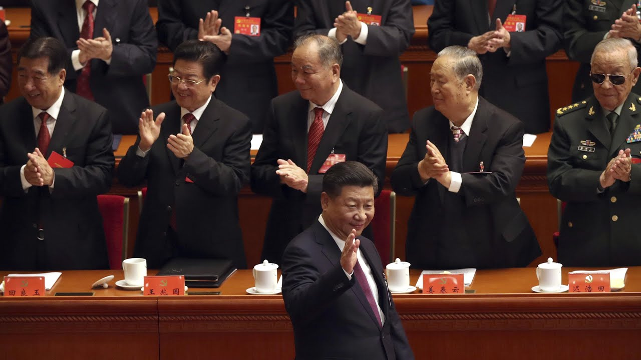 Delegates clap and sing as Xi Jinping opens Communist party congress