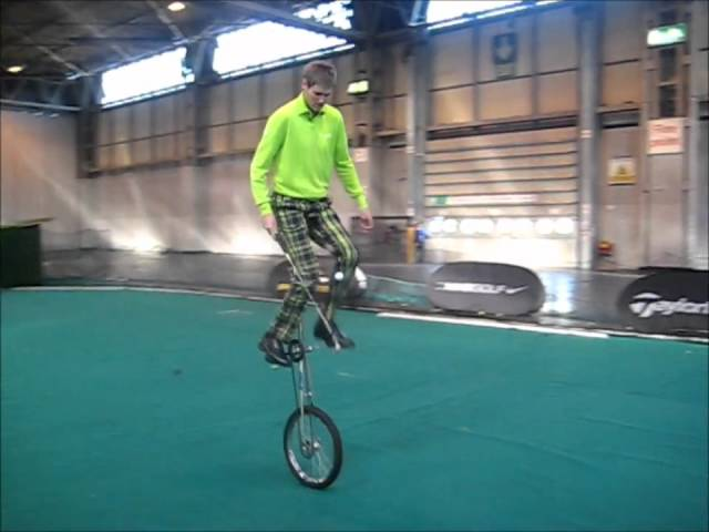 Golf Trick Shots on a Giraffe Unicycle by Kevin Carpenter at the  NEC