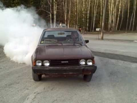 JUST ANOTHER DAY IN PAGE BURN OUT !!!!!!!!! Toyota Corolla Burnout The tire lets go right at the end.