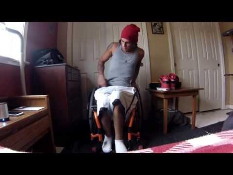 Paraplegic getting dressed in wheelchair