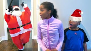Bad Baby Santa Claus ATTACKS! Christmas Present EXPLOSION - Onyx Kids