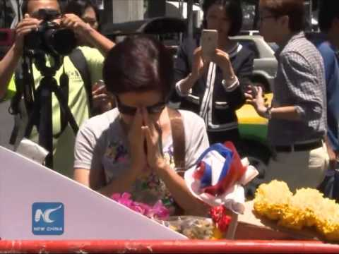 Bangkok bomb attack latest- shrine reopens as police hunt goes on