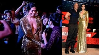 Deepika turns true Hollywood babe in deep neck gown