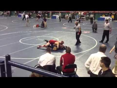 Cody Gaskill wrestling against Mount Airy High School in th