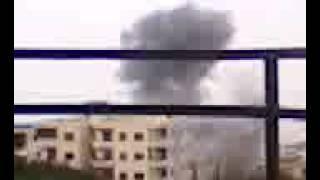 ريف اللاذقية -سلمى--لحظة رمي البرميل  25-9-2012  .3gp