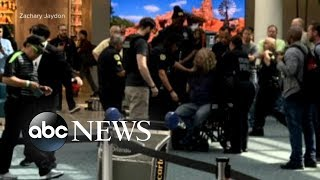 Police detained a man who tried to breach airport security in Orlando