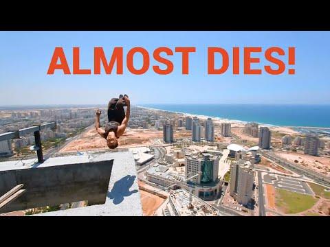 Guy Backflips on the Top of a Skyscraper Platform | ALMOST DIES