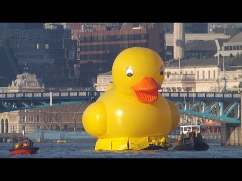 Giant yellow duck at Tower Bridge
