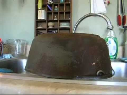 Clean rusty cast iron with vinegar and water.