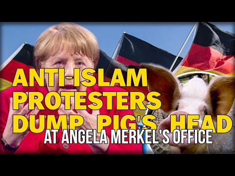 ANTI-ISLAM PROTESTERS DUMP PIG'S HEAD AT ANGELA MERKEL'S OFFICE