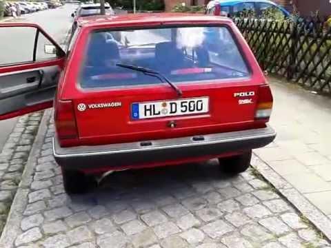 Girl cranking old VW Polo Fox