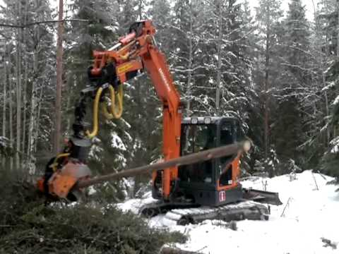 Wintertime forest harvesting with light Doosan DX 60R Excavator and Roller Head.mp4