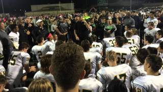 West Linn football coach Chris Miller talks to team after 48-28 win at Tigard