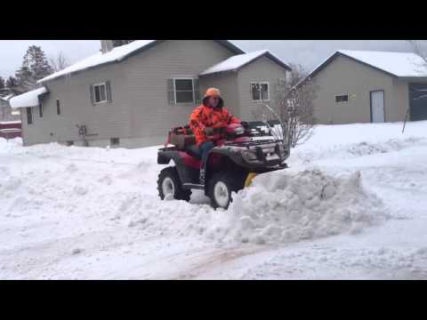 Honda foreman plowing snow