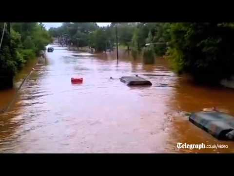 Submerged US Army truck drives through Irene flood waters