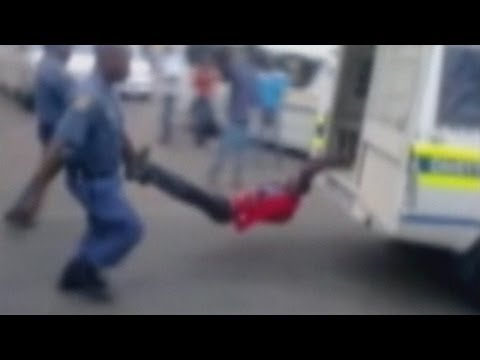 GRAPHIC VIDEO: Man tied and dragged behind a police van in South Africa