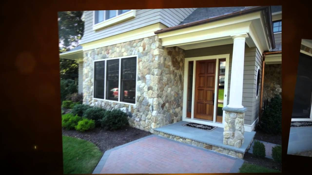 Home With Round Natural Stone Siding Columns And Chimney