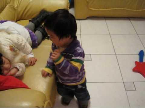 Little boy kissing his sister