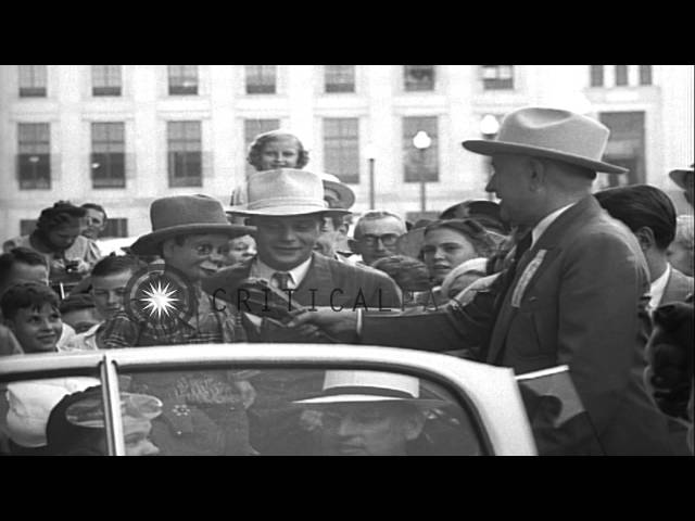 Edgar Bergen with his doll Charlie McCarthy interviewed during a parade in Forth ...HD Stock Footage