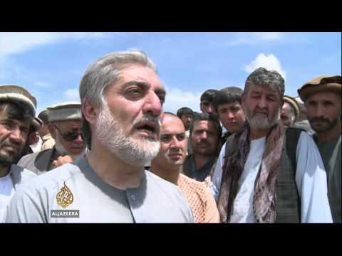 Afghan gunfire disperses aid workers helping landslide victims
