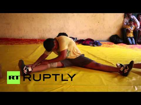 India: Meet Delhis knockout girls who wrestle the opposite sex...