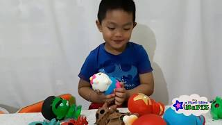 unboxing and playing squishy action figures captain America, hulk, iron man and spiderman