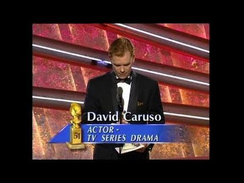 "Marlee Matlin and John Corbett present the Actor in a TV Series Drama award to David Caruso for his performance in ""NYPD Blue."" He thanks the Hollywood Forei..."