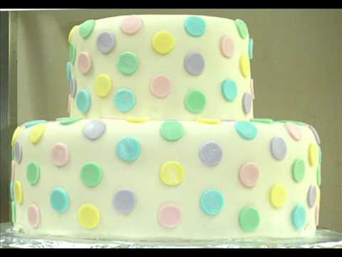 This cake is made with rolled fondant. The dots have been brushed with 'Pearl Dust'  to add a beauti