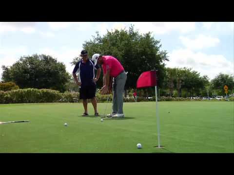 G-Mac Surprises Amateur with an Impromptu Lesson on the Putting Green