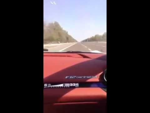 Sebastian Vettel driving Ferrari F12 at 350 km/h on public highway