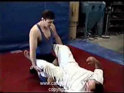Tony Cecchine's American Catch Wrestling:  bait and counter to open guard sweep Image 1