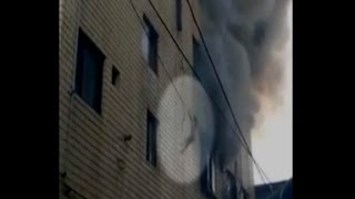 Babies dropped from burning building