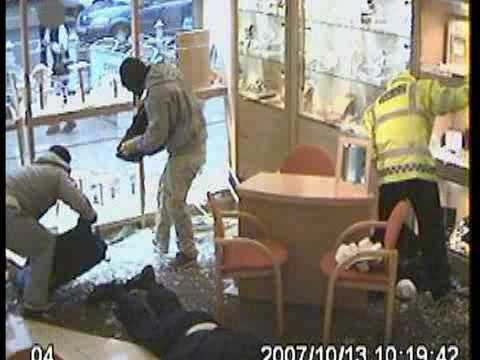 Surveillance camera catches this attack on an adult book store clerk with a ...