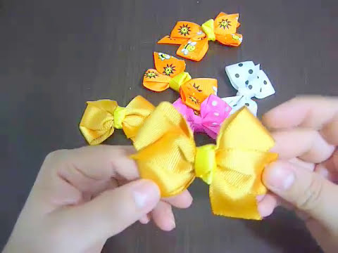como hacer un moño pequeño en cinta para decorar peinados en citas. video No.80