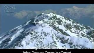 Watch John Denver Wrangle Mountain Song video