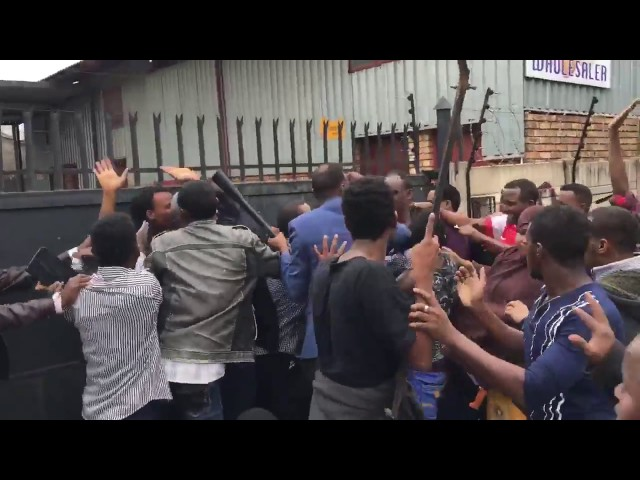 SA National caught robbed by Xenophobia Protestors - saved by police
