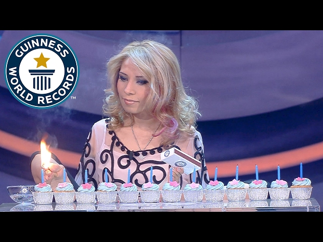 Most birthday candles lit with the feet in one minute - Guinness World Records